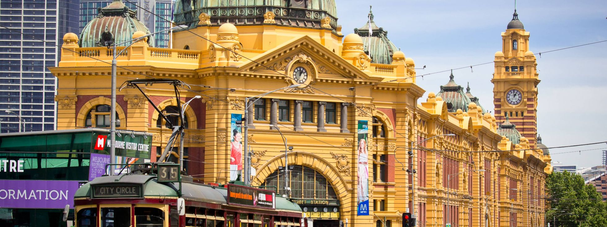 Melbourne Flinders street station as city tram passes by